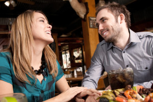 Happy Couple Dating In Restaurant